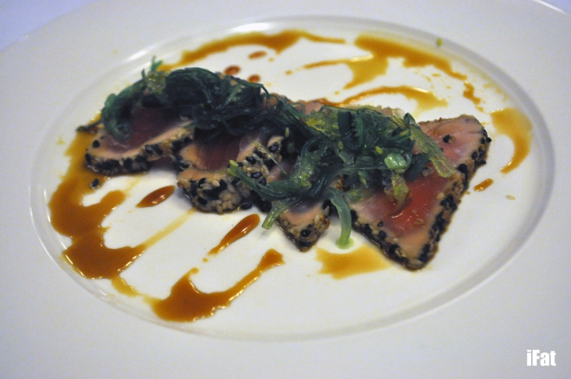 Sesame crusted yellow fin tuna with wakame seaweed, pickled ginger, and a soy ginger glaze
