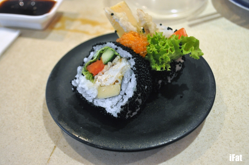 Soft shell crab roll with black sesame, tamago, cucumber and capsicum