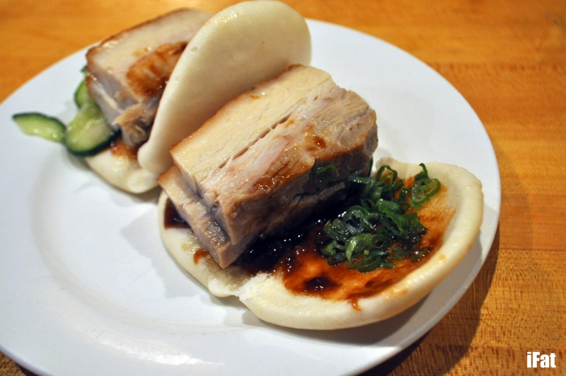 Momofuku pork buns with hoisin sauce, scallion and cucumber.