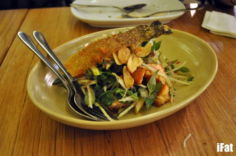 Fried crispy skin salmon and green papaya salad with Vietnamese mint and fried garlic