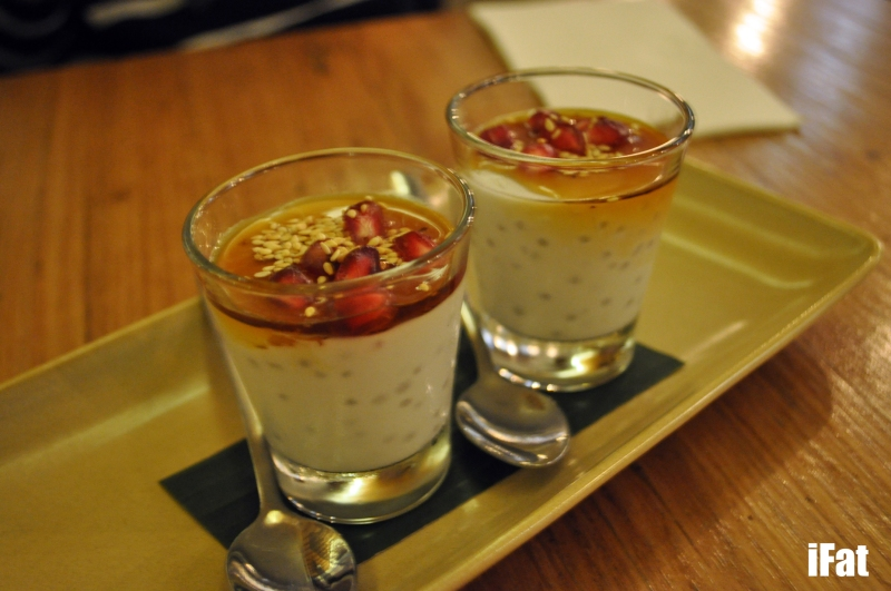 Chi's Coconut Tapioca Shot with seasonal fruit and sesame seeds